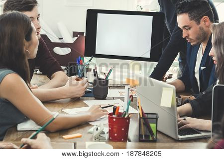 Group of interior designers in brainstorming session
