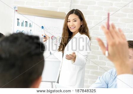 Young Asian businesswoman making a presentation and asking for opinion in the meeting - female leader concept