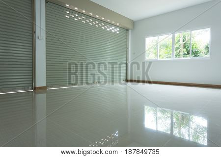 Empty Room In House Residential Building With Aluminium Roller Shutter Door And Window Glass Sliding