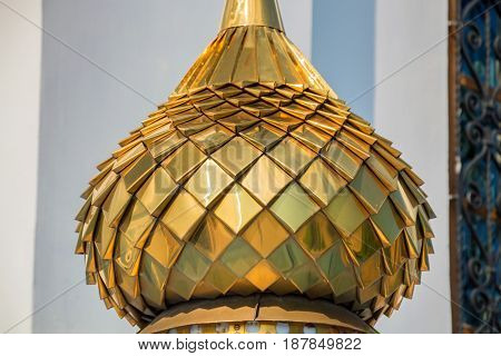 Closeup image of golden bulbous dome of Russian Orhodox church