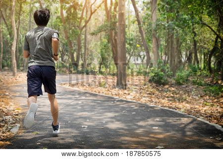 running man. Male runner at sprinting speed training for marathon outdoors.