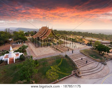Bodhi tree glow Wat Sirindhornwararam (Phu Prao Temple) Ubon Ratchathani Thailand. temple aerial view Thailand. Wat sirindhorn wararam at night Ubon Ratchathani at Thailand sunset.