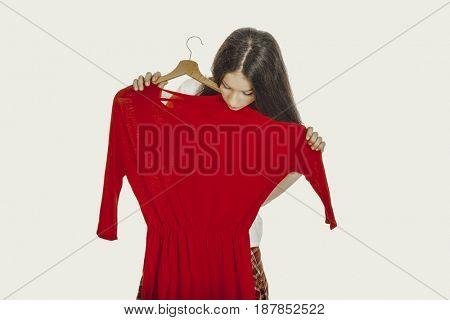 Beautiful woman holding red dress.
