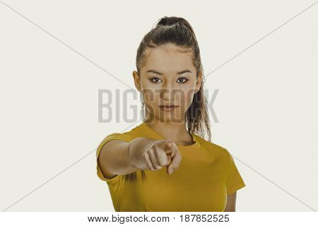 Young woman pointing on you.