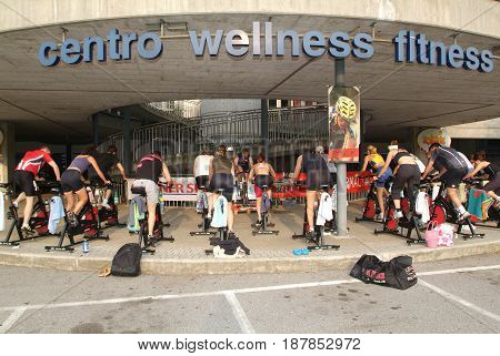 Lugano, Switzerland -17 June 2005: People pedaling during a spinning class on a gym of Lugano on Switzerland