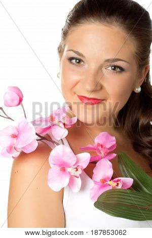 portrait of young woman and pink orhid on white background