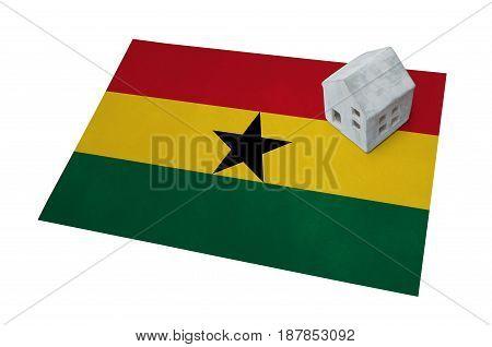 Small House On A Flag - Ghana