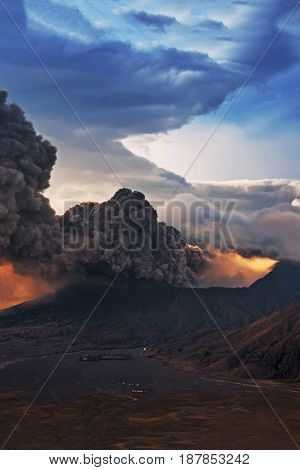 Mount Bromo volcano (Gunung Bromo) eruption during sunrise from viewpoint on Mount Penanjakan. Mount Bromo located in Bromo Tengger Semeru National Park East Java Indonesia.