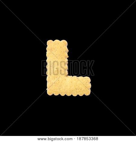 Closeup brown biscuit in L english alphabet isolated on black background with clipping path