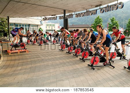 Lugano Switzerland -24 June 2005: People pedaling during a spinning class