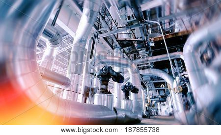 Industrial Factory. Various Mechanisms And Metal Pipes. Toned Image. Motion Blur Effect.
