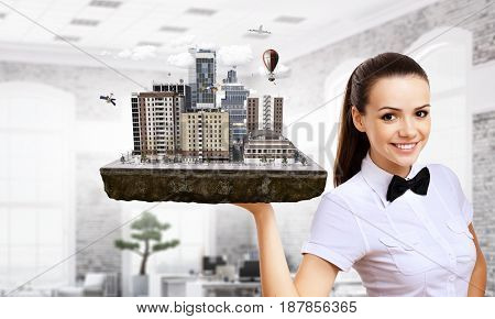 Woman presenting construction model. Mixed media . Mixed media