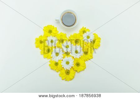 Top View Of Beautiful White And Yellow Chrysanthemum Flowers In Heart Shape And Cup Of Coffee Isolat
