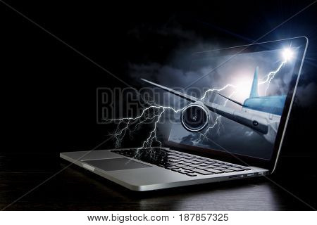 Airplane in laptop screen. Mixed media . Mixed media