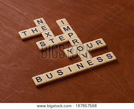 Crossword Puzzle With Words Next, Step, Business. Start Up Concept.