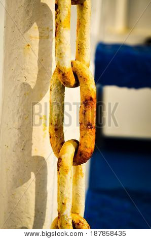 white rusty chain in sunlight with shadow closeup