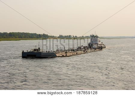 Overloaded tanker. Barge, tug. The Volga River, Russia