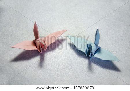 Thai man folding bird paper or Origami Crane japanese style