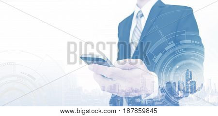 Businessman using smartphone with copy space, telecommunication network technology concept