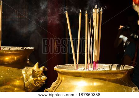 incense stick in a golden bowl at chinese temple