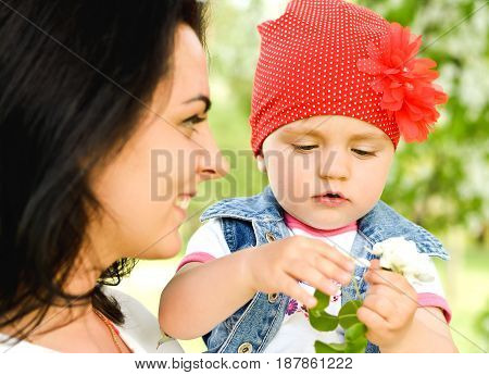 mother with little cute girl in the park