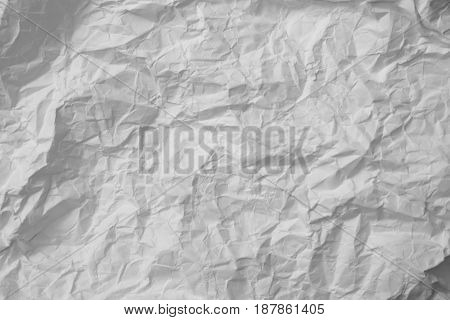 The surface of the crushed sheet of white paper