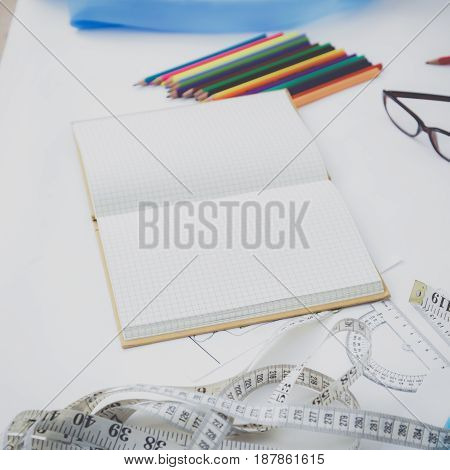 Designer's table with blank note and tools