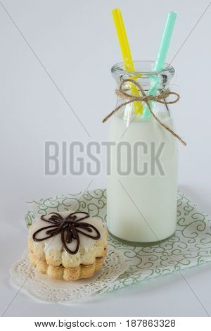 Biscuit decorative cookies with jam and glaze, with  milk on white background
