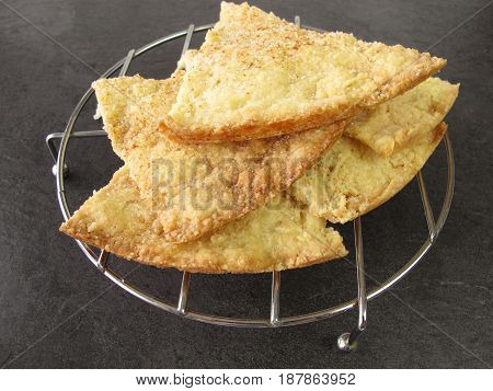 Homemade crumbly baked shortbread cake with cinnamon