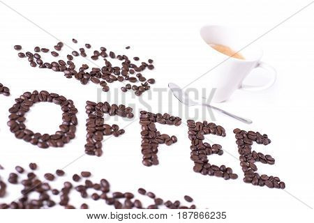 Coffee background inscription of roasted coffee beans cup of coffee and spoon isolated on white background espresso coffee time design for your coffee shop