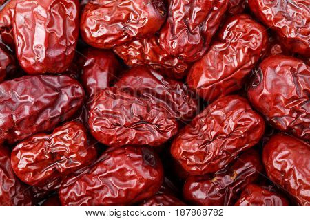 Dried jujube fruits red dates as background