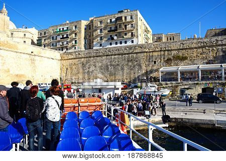 VALLETTA, MALTA - MARCH 30, 2017 - Passengers disembarking a ferry just returned from Sliema Valletta Malta Europe, March 30, 2017.