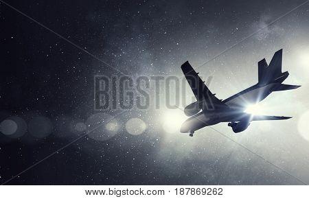 Airliner in night sky