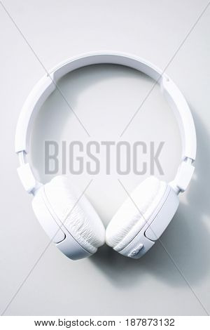 Modern white headphones Isolated on white background.