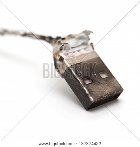 burnt out usb cable close up on white