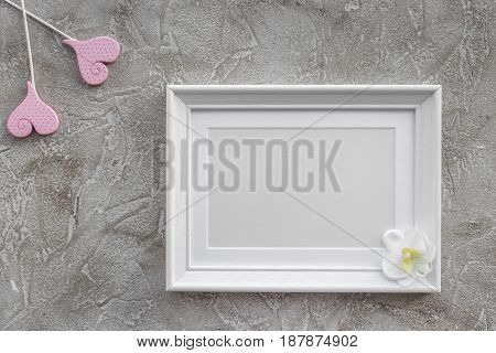 presents set for baby shower with frame on gray stone background top view mockup