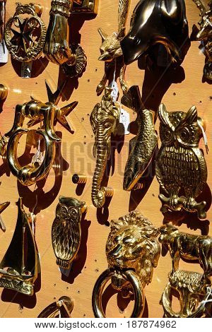 Brass door knockers for sale in a shop along Republic Street aka Triq Ir Repubblika Valletta Malta Europe.