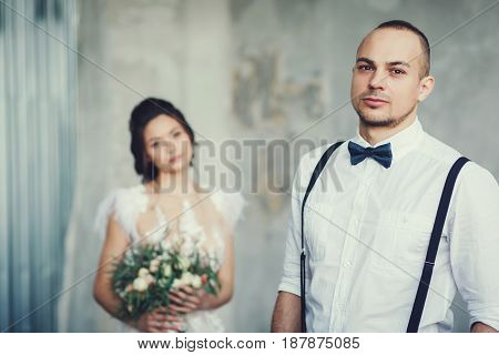 In love with a wedding couple. Focus on the groom