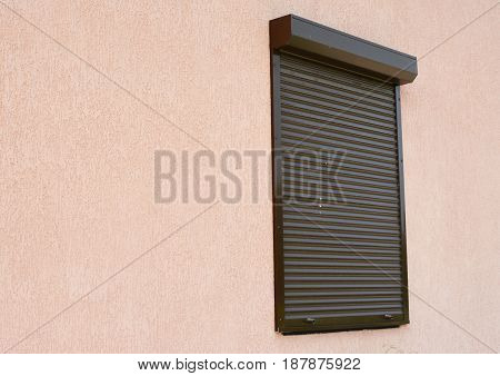 Window with rolling shutter and copy space. Window with rolling shutter for house protection.