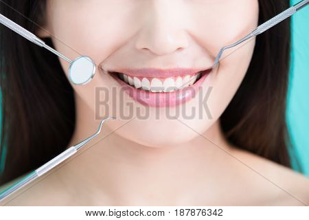 beauty woman with tooth tools on the green background