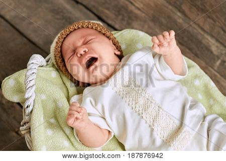 Caucasian baby crying. Little kid screaming. How to soothe an infant.