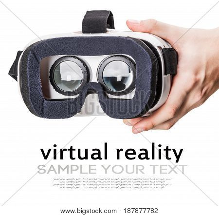 Hand holding virtual reality glasses isolated on white background. Delete text