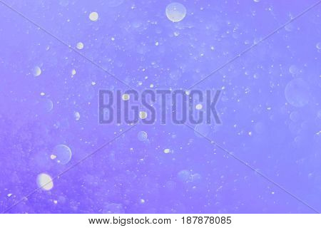 A beautiful and blurry bokeh on a purple background.