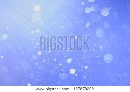 A beautiful and blurry bokeh on a blue background.