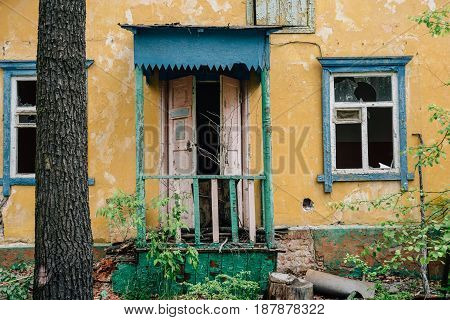 Facade of abandoned house, demolished ruined house, abandoned Soviet building