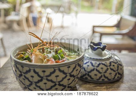 Tom Yam Kung Spicy tom yum soup with shrimp in ceramic bowl delicious thai food.