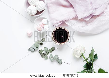 woman light breakfast with marsh-mallow and coffee on white table background top view