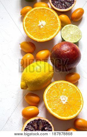 set of citrus fruits orange red lemon kumquats and fresh mint leaves