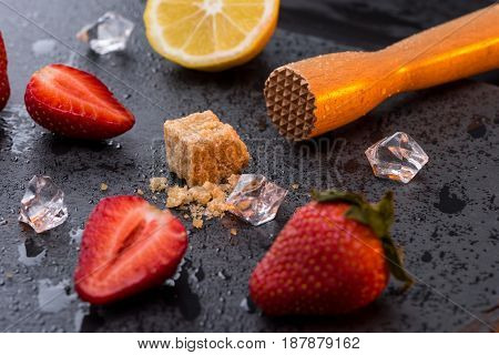 Wooden Squeezer With Lemon And Strawberries Slices On Stone Board, Barman Cocktail
