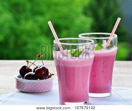 Healthy pink smoothie liquid food with Greek yogurt in glasses